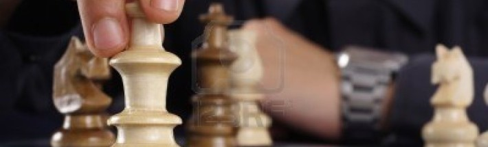 11084201-businessman-playing-chess-game-makes-his-move
